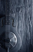 Blue guitar on aged wood — Stock Photo