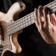 Playing bass guitar — Stock Photo #46764001