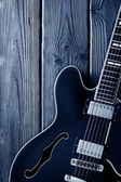 Electric guitar on blue — Stock Photo