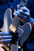 Playing blues guitar — Stock Photo