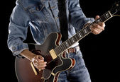 Man playing rock and roll — Stockfoto