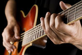 Playing country guitar — Stockfoto