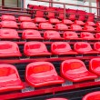 Red plastic seats in stadium — Stock Photo