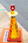 Lighting and traffic cone — Stock Photo