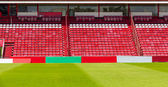 Red and white seats in stadium — Stock Photo