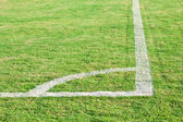 Corner of green football ( soccer ) field — Stock Photo