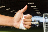 Thump up by bandage hand — Stock Photo