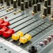 Closeup on sliders of sound mixing console in audio recording — Stock Photo