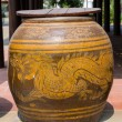 Water jar with dragon pattern and wooden lid — Stock Photo #40360559