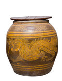 Water jar with dragon pattern and wooden lid on white — Stock Photo