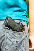 Handgun in pocket — Stok fotoğraf
