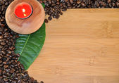 Wood table with candle and coffee — Stock Photo