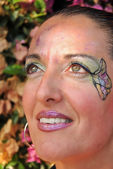 Woman with face painted — Stock Photo