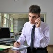 Young businessman talking on phone  — Stock Photo