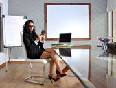 Business woman in her office — Stock Photo