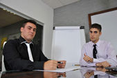 Two businessmen sitting in his office — Stock Photo