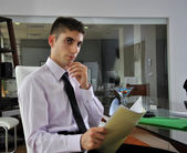 Businessman sitting in his office — Stock Photo