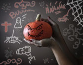 Halloween pumpkin possessed by evil — Stock Photo