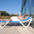 Woman lying on a lounger  — Stock Photo