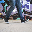 Legs of a walking break dance — Stock Photo