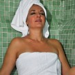Woman sitting in a Turkish bath  — Stock Photo