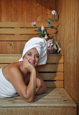 Woman relaxing in a sauna — Stock Photo