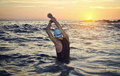 Young athlete triathlon in front of a sunrise — Stock Photo