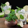 Stock Photo: Glass of mojito cocktail with mint