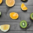 Stock Photo: Oranges, limes and kiwis