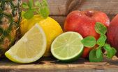 Pineapple, red apples, lemons — Stock fotografie