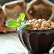 Raw chickpeas in a brown bowl — Stock Photo #39261899