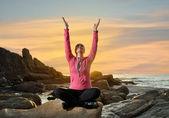 Woman doing yoga exercises — Stock Photo