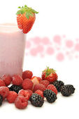 Glass of strawberry milkshake s — Stock Photo