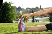 Young woman doing stretching — Stock Photo