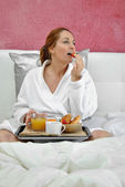 Woman breakfast in her bed — Stock Photo