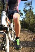 Sportsman riding mountain bike — Stock Photo