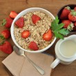 Bowl of cereal with milk and strawberries — Stock Photo #46286301