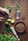 Hands preparing mojito cocktail  — Stock Photo