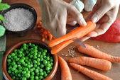 Hand cutting  vegetables for cooking — Stock Photo