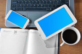 Table with tablet, phone and PC  — Stockfoto