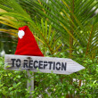 Wooden pointer to reception of a tropical hotel — Stock Photo #21074313