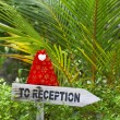 Wooden pointer to reception of a tropical hotel — Stock Photo #21074395