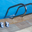 Stock Photo: Sunglasses by swimming pool