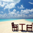 Two chairs and one table are on a beach — Stock Photo
