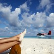 Airwoman has a rest on a beach — Stock Photo