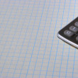 Calculator on white sheet — Stock Photo