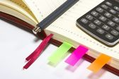 Notebook with pen and calculator — Stock Photo