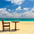 Chairs and table are on beach — Stock Photo #22207535