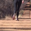 Stock Video: Womwalking up Manitou Incline