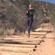 Stock Video: Womrunning up Manitou Incline